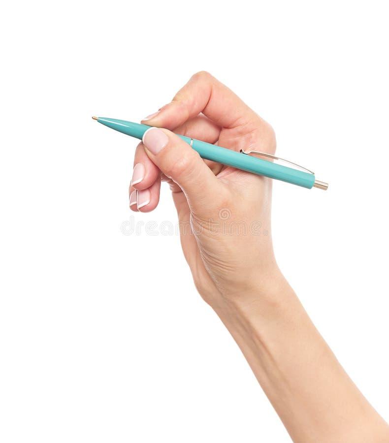 Błękitny pióro w ręce zdjęcie stock