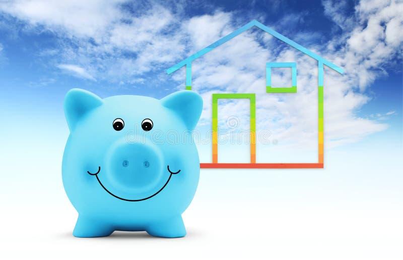 Błękitny prosiątko bank z domowym kształtem odizolowywającym na niebieskiego nieba tle, zielonym budynku i energii oprócz pojęcia zdjęcia royalty free
