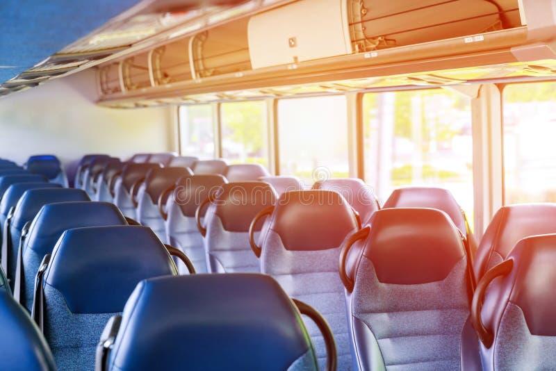 Błękitny siedzenie w wnętrzu trener na autobusie obrazy royalty free
