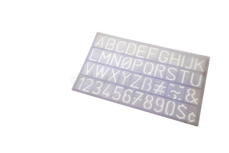 Bławy abecadło matrycuje pisać list PVC władcy plastikowego szablon obrazy stock