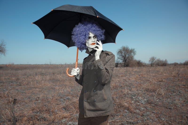 Błazen z parasolem obrazy stock