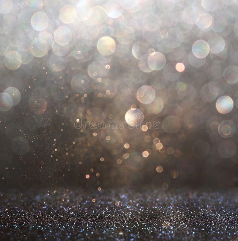 Błyskotliwość rocznik zaświeca tło ciemny złoto i czerń defocused obrazy royalty free