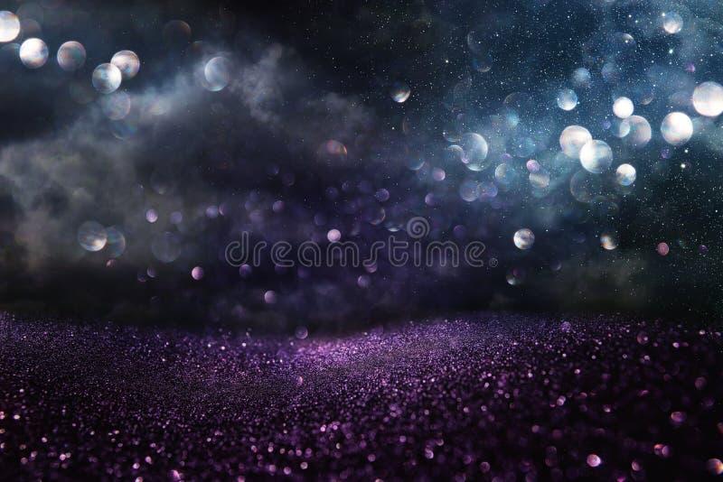 Błyskotliwość rocznik zaświeca tło czarny, błękitny, purpuro i srebro, skupiający się zdjęcie royalty free