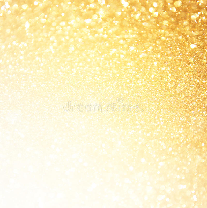 Błyskotliwość rocznik zaświeca tło złoto tła abstrakcyjne defocused