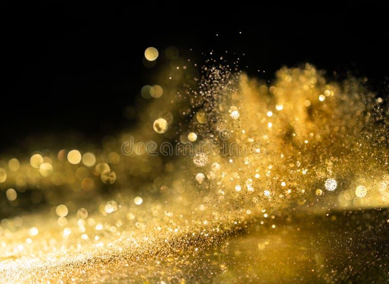 Błyskotliwość zaświeca grunge tło, złocistej błyskotliwości świateł defocused abstrakcjonistyczny Twinkly tło zdjęcie royalty free