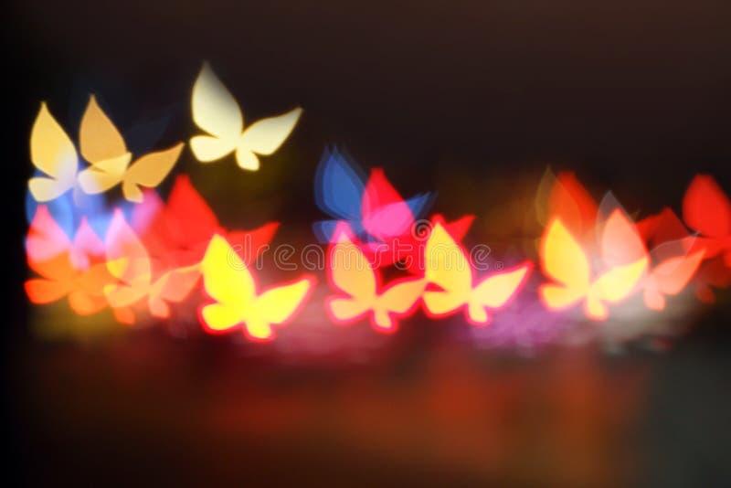Błyskotliwy motyl na bokeh tle zdjęcie stock