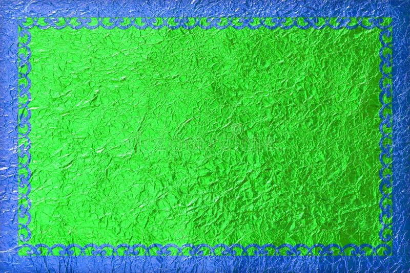 Błyszcząca błękit rama z wzorem na zielonym foliowym tle obraz stock