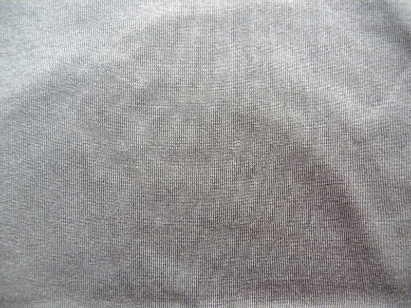 Błyszczącego szarość koloru bawełniany ubraniowy tło zdjęcie royalty free