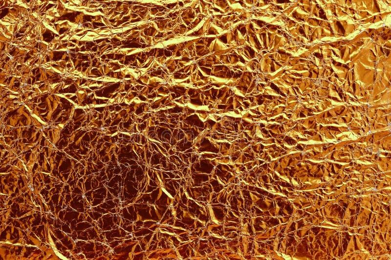 Błyszczący ciemny retro żółty liść złocistej folii tekstury tło zdjęcia royalty free