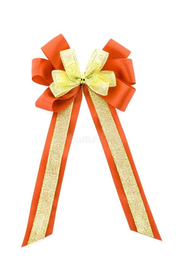 Błyszczący czerwony złocisty atłasowy faborek na bielu zdjęcie royalty free