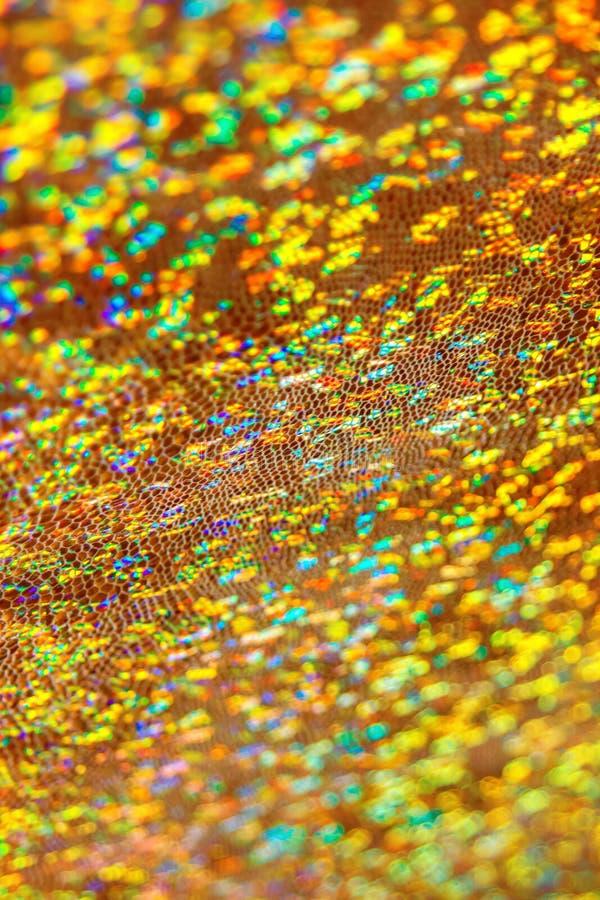 Błyszczący złocisty tkaniny bokeh fotografia stock