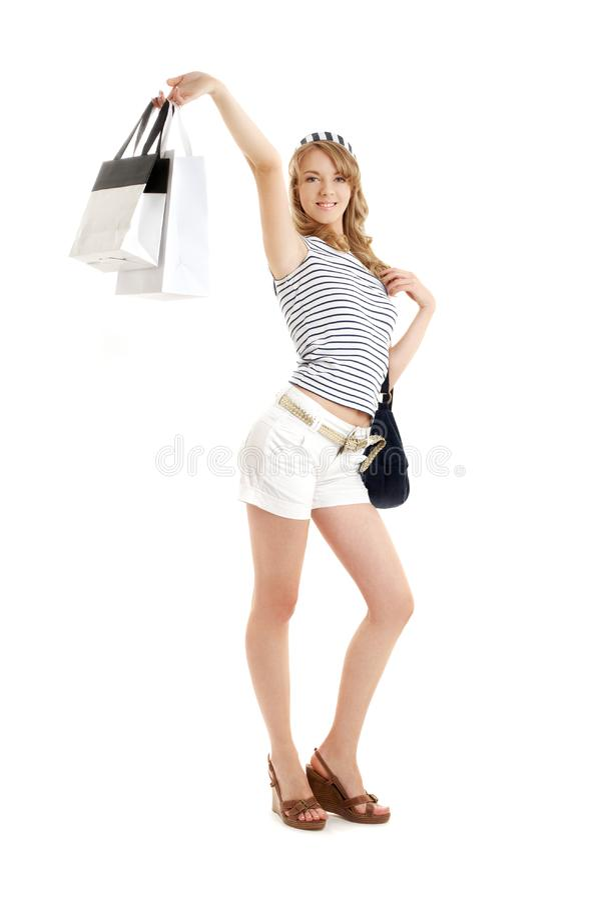 b白肤金发的快乐的购物 免版税库存图片