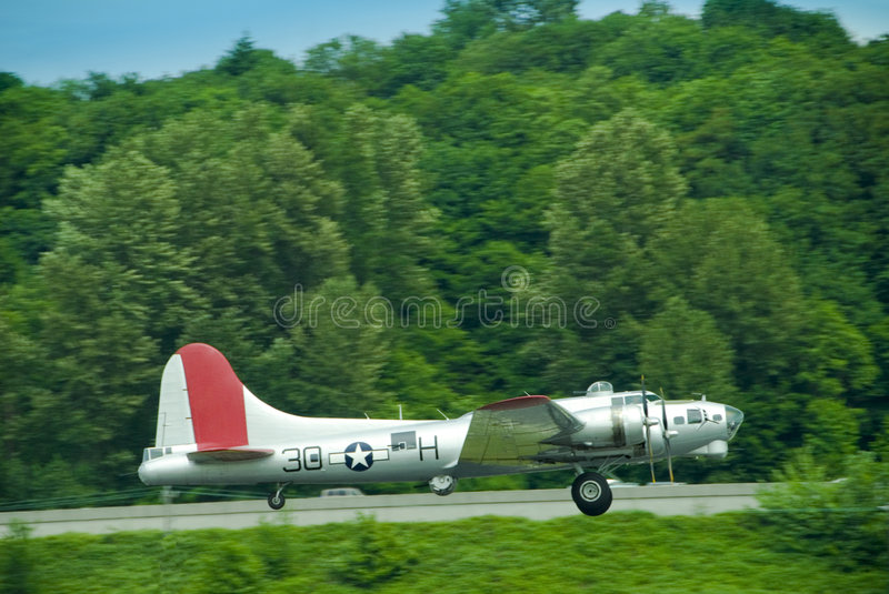 B-17 Taking Off. B-17 Flying Fortress Aluminum Overcast on take of in Seattle, WA stock photo