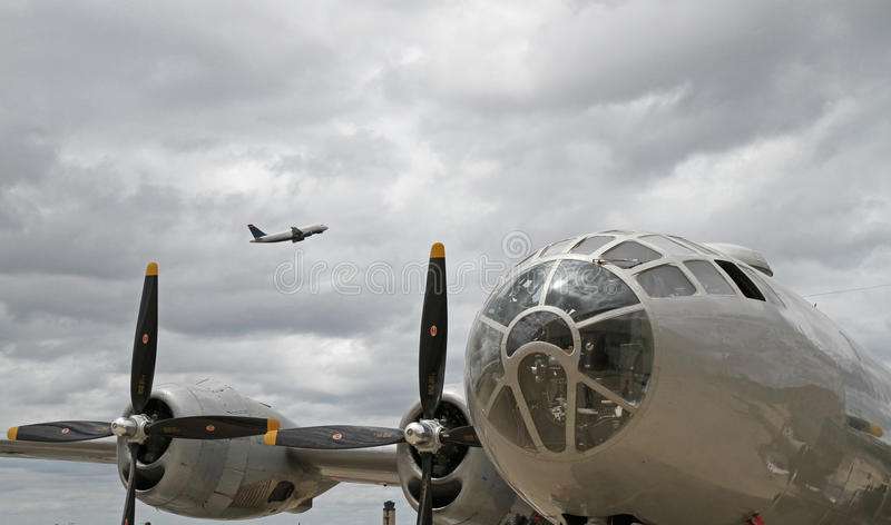 Download B-29 Bomber With Modern Passenger Jet Overhead Stock Photo - Image: 26304156