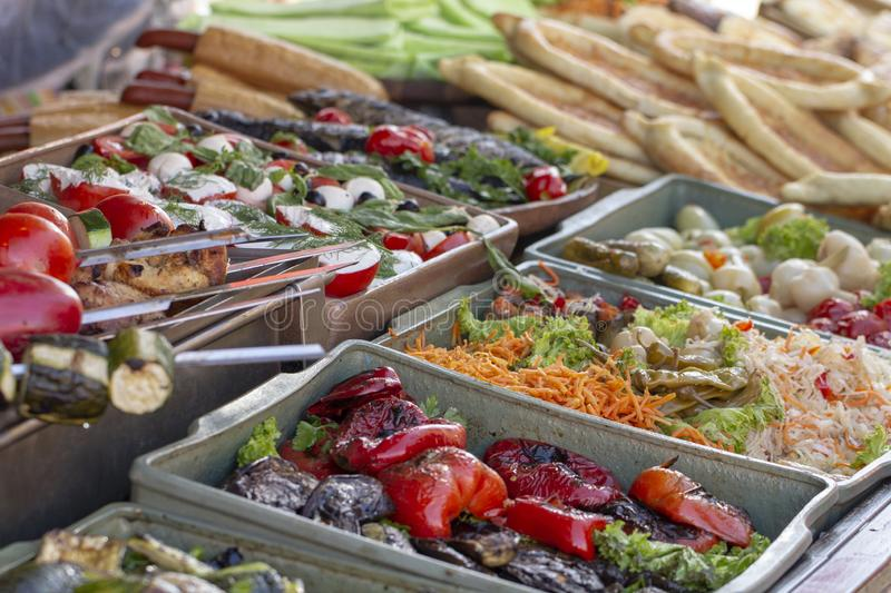 B-B-Q. vegetarian street food. Vegetables and fruits cooking on an open fire. Close up royalty free stock photo