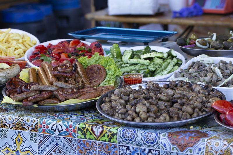 B-B-Q. vegetarian street food. Vegetables and fruits cooking on an open fire. Close up royalty free stock photography