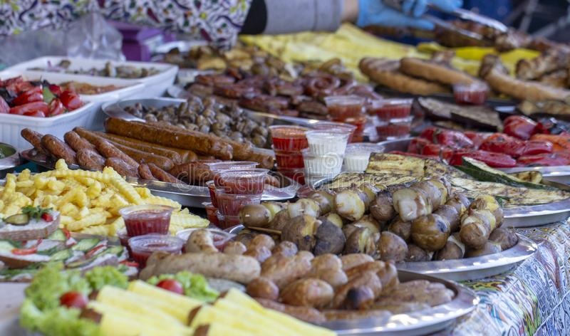 B-B-Q. vegetarian street food. Vegetables and fruits cooking on an open fire. Close up royalty free stock images