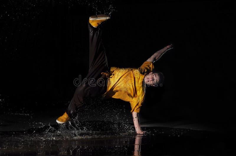 B-boy dances in water royalty free stock photo