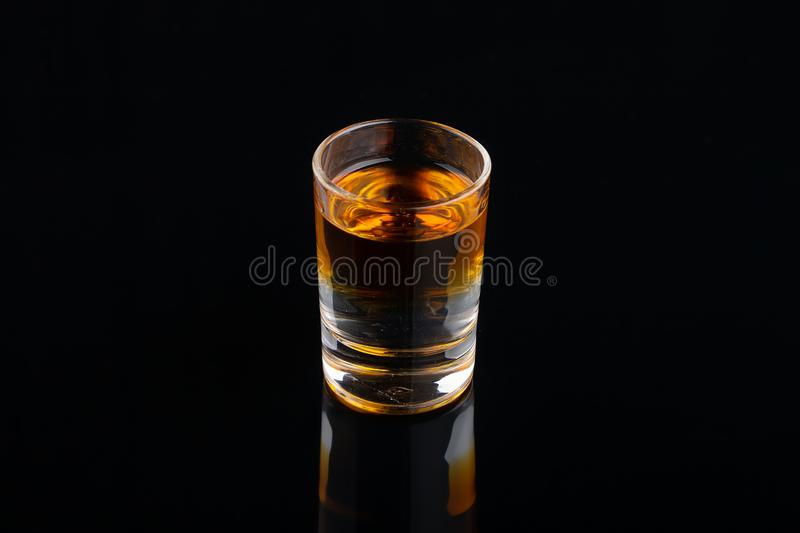 The B-52 cocktail shot on black background royalty free stock photo