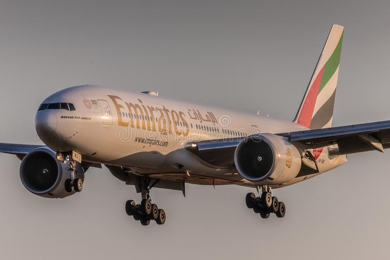 B777 Emirates. PRAGUE, CZECH REPUBLIC - JULY 25: Boeing 777-200LR of Emirates landing at PRG Airport in Prague on July 25, 2019. Emirates is an airline based in royalty free stock photos