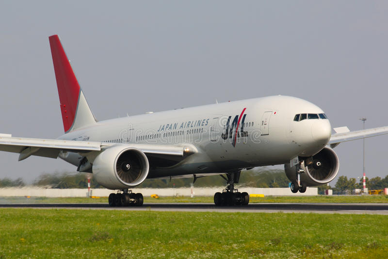B777 JAL. PRAGUE - AUGUST 24: B777 Japan airlines lands in PRG in Prague, CZE on August, 2011. Japan Airlines ( JAL ) operates almost 900 daily flights royalty free stock photography