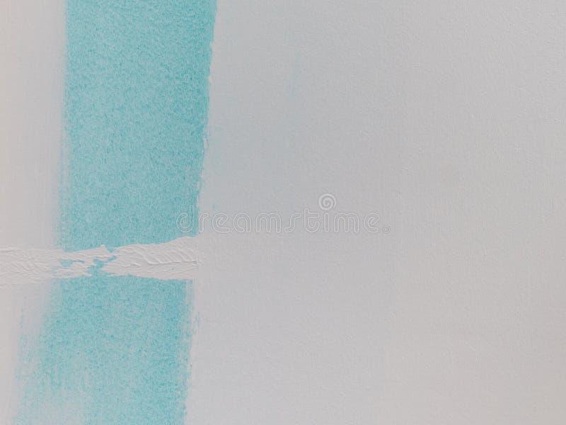 B??kitny farby swatch na biel ?cianie zdjęcie royalty free