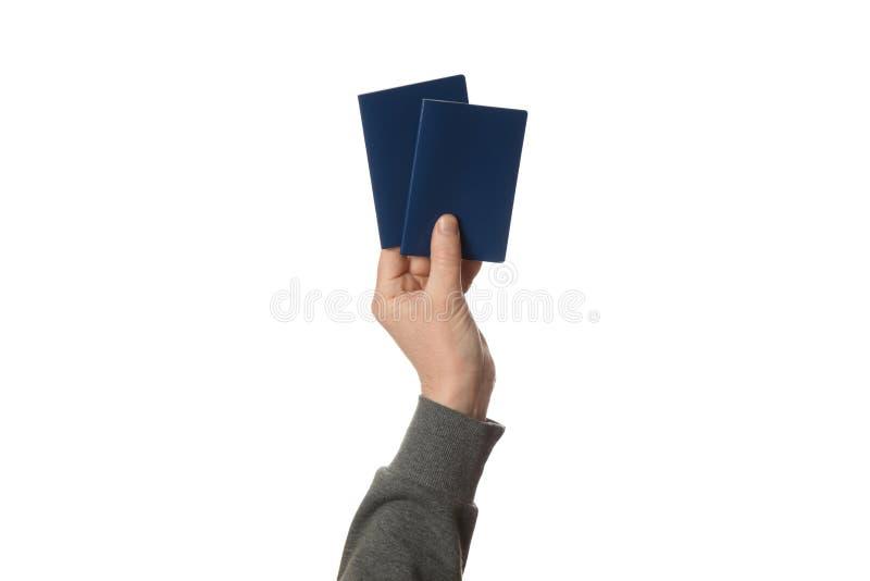 B??kitny paszport w r?ce odizolowywaj?cej na bia?ym tle Zwyczaj podr?? i kontrola zdjęcie stock