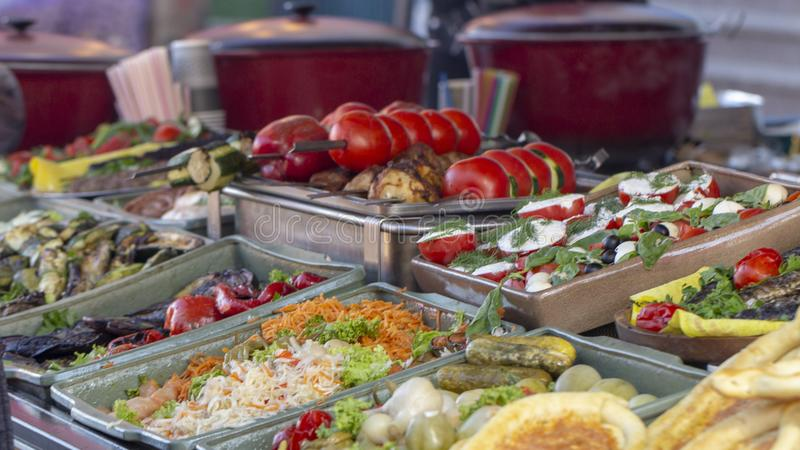 B-B-Q. vegetarian street food. Vegetables and fruits cooking on an open fire. Close up royalty free stock photos