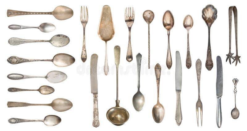 B?sta sikt av den h?rliga den tappningsilverkniven, skeden och gaffeln som isoleras p? vit bakgrund silverware fotografering för bildbyråer