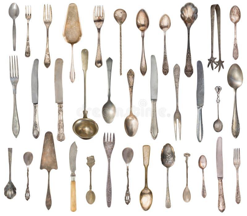 B?sta sikt av h?rliga tappningsilverknivar, skedar och gafflar som isoleras p? vit bakgrund silverware royaltyfri fotografi