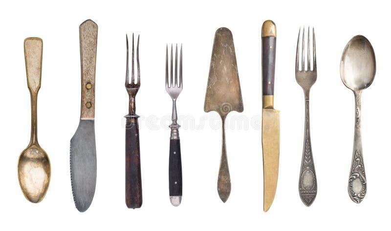 B?sta sikt av h?rliga tappningsilverknivar, skedar och gafflar som isoleras p? vit bakgrund silverware royaltyfri foto