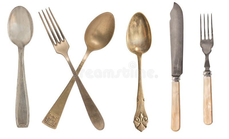 B?sta sikt av h?rliga tappningsilverknivar, skedar och gafflar som isoleras p? vit bakgrund silverware royaltyfria foton