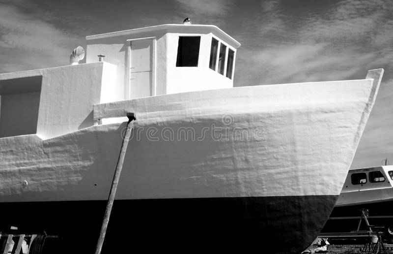 B & W fishing boat on dry dock. Black and white fishing boat on dry dock in Lewisporte NL marina stock photos