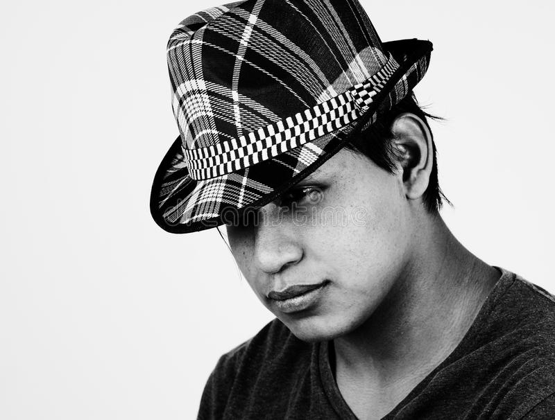 B&W portrait of young latino man with hat royalty free stock photography