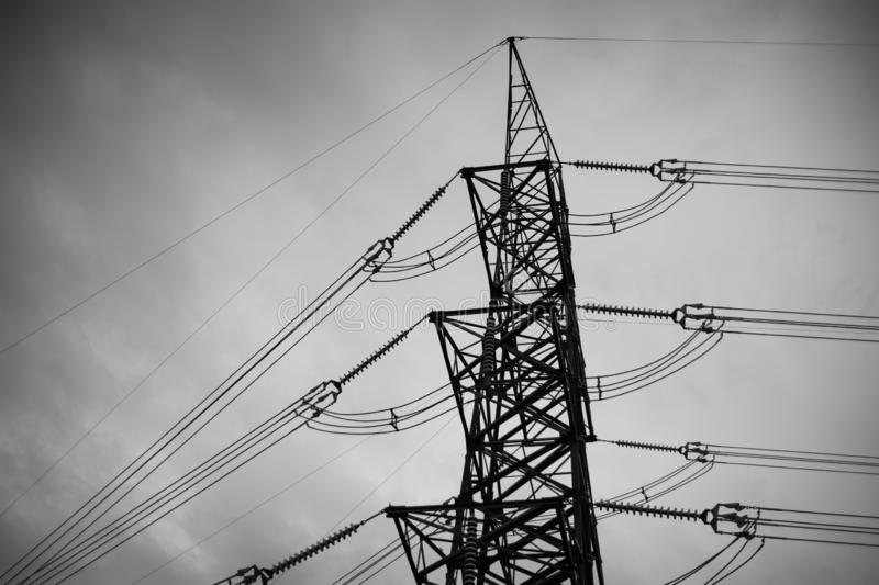 B&W power line, high voltage Pole, High voltage tower sky background stock photo