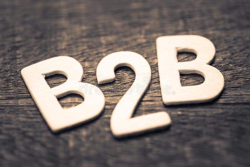 B2B Wood Letters. Closeup wood letters of B2B abbreviation Business to Business on wood background stock images