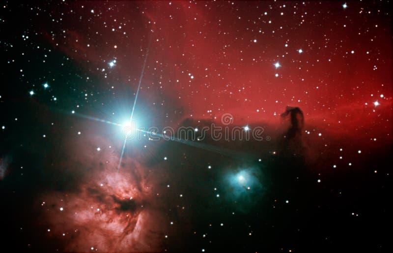 B33 y NGC 2024 - Horsehead y nebulosa de la llama imagenes de archivo
