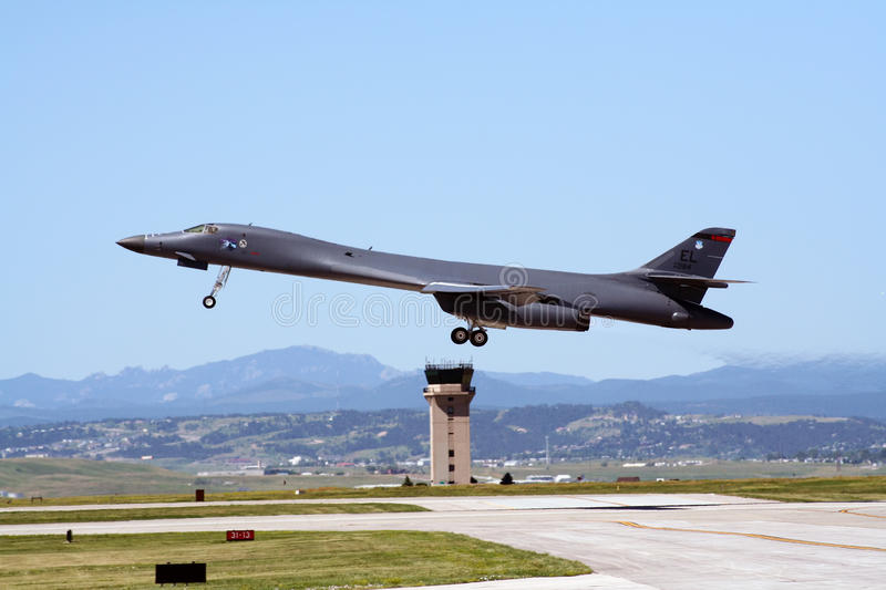B1 Lancer The Bone. The B-1 Lancer The Bone is a four-engine variable-sweep wing strategic bomber used by the United States Air Force (USAF). Here one takes off stock image