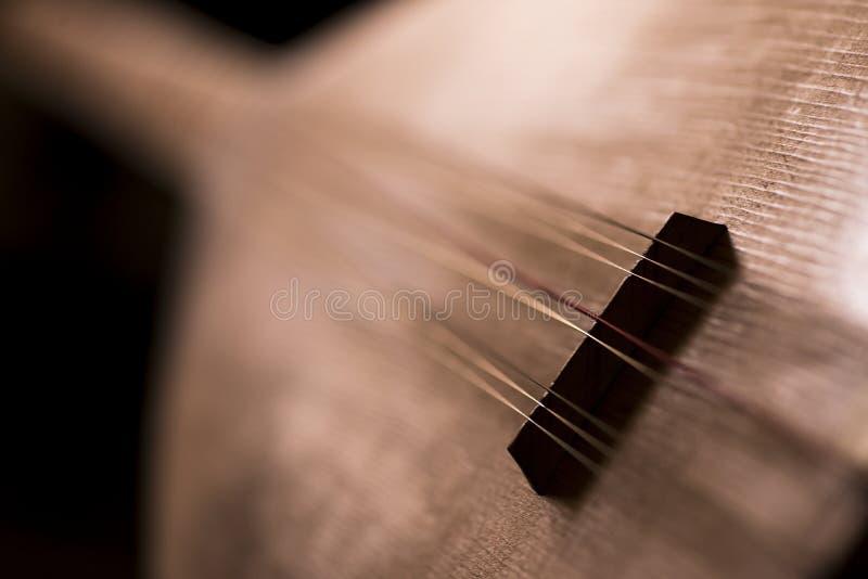 BaÄŸlama eller Saz (den turkiska folken Instrumant) arkivbild