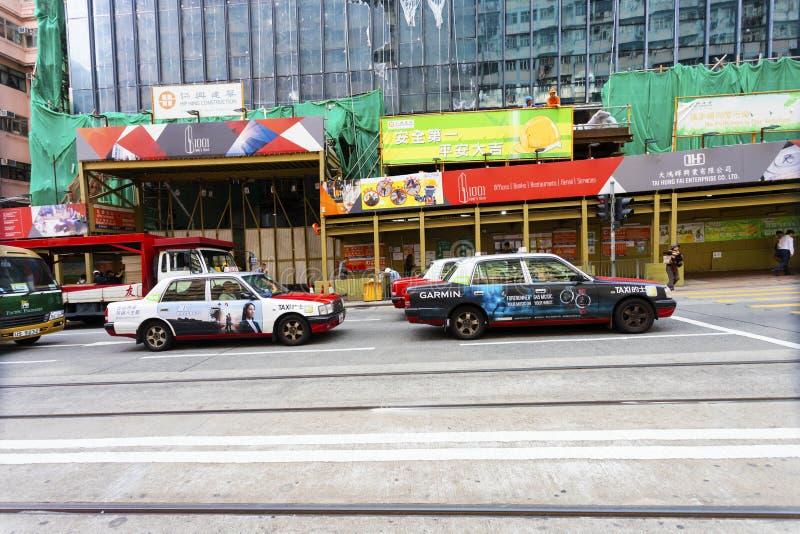 Baía da calçada, Hong Kong - 23 de novembro de 2018: Táxis na rua em Hong Kong imagem de stock