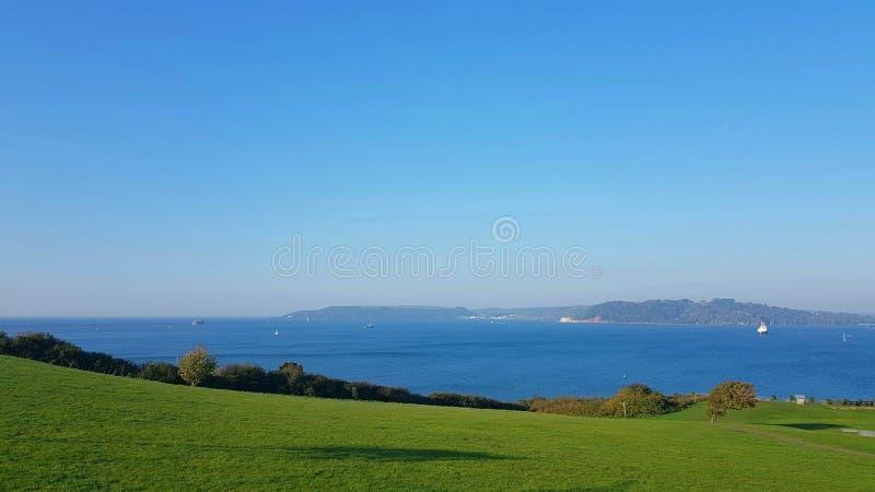 Baía de Jennycliff e som de Plymouth imagens de stock