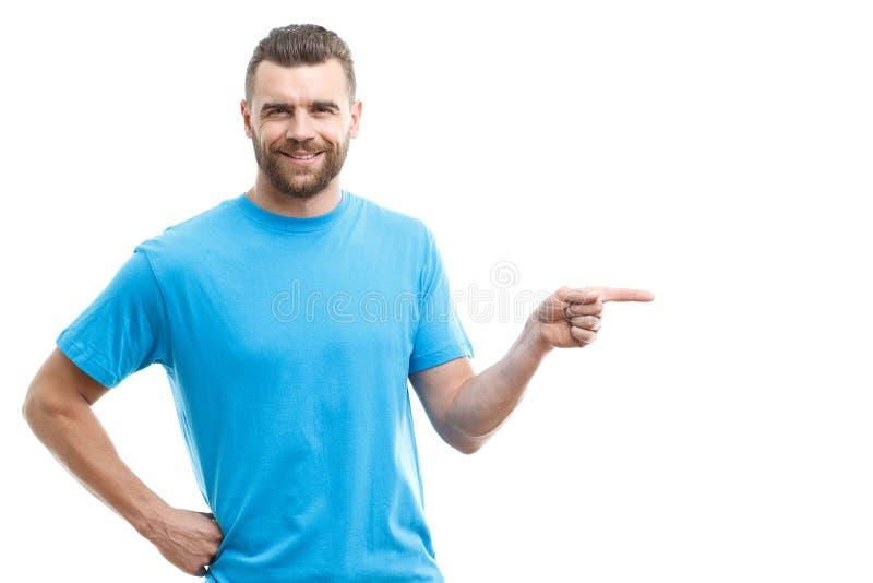 Baard-mens die opzij met vinger richten stock foto's