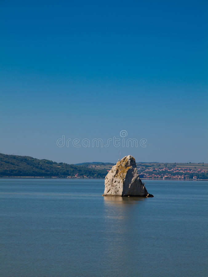 Baba Caia rock in Danube stock photography