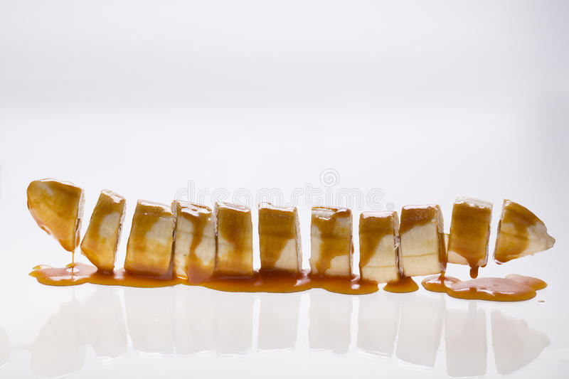 Banana slices with caramel royalty free stock photography