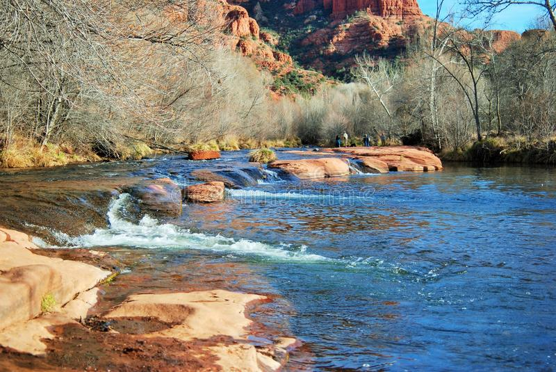 The babbling water of Oak Creek near Sedona, Arizona. This is the slow-moving water of Oak Creek, near Sedona, Arizona. The water reflects the blue of the sky as royalty free stock photos