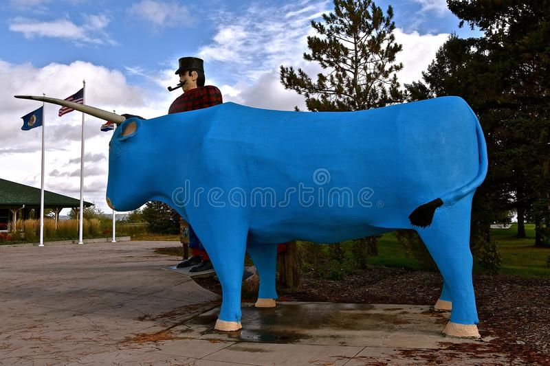 Babe the Blue Ox and Paul Bunyan. BEMIDJI, MINNESOTA, October 1, 2017: The legendary Paul Bunyan statute is a tourist attraction run by the parks system of stock photos