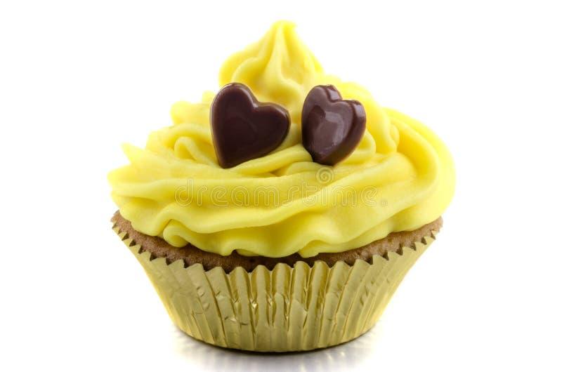 Babeczka z żółtą masło śmietanką fotografia royalty free