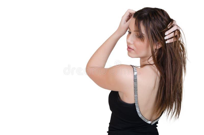 Babeface kvinnligt posera i den iklädda svarta klänningen för studio arkivbilder