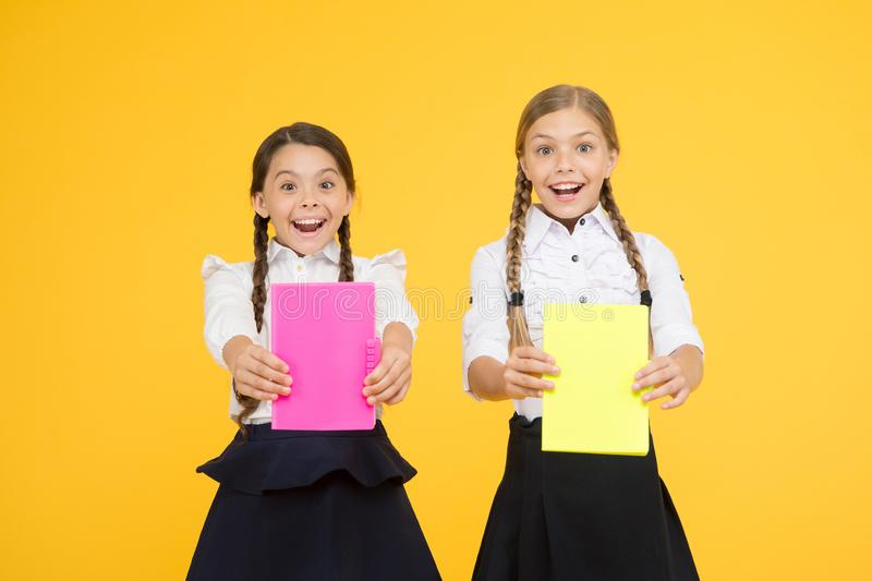 Babes in Bookland. cheerful classmates with workbook. reading story. childrens literature. kids learning grammar. back. To school. Get information. little girls stock photography