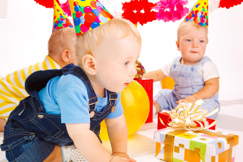 Babies at birthday party royalty free stock photography